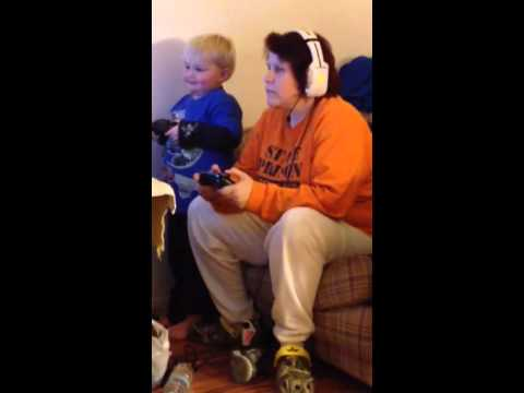 Mom teaching son how to play video games