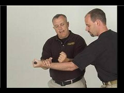 Edged Weapon Defense: Hook Attack : Defending a Hook Attack: Inside Forearm Disarm