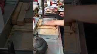Fish stomach being pounded to make a snack in Tainan, Taiwan