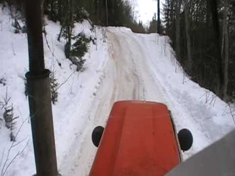 Driving zetor up a hill ,when into forest.