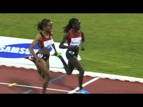 Cheruiyot battles Defar down the home stretch to take the 3000m at Doha
