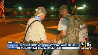 Group of armed veterans protecting homeless vets