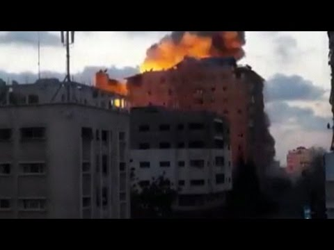 Dramatic footage of apartment block collapsing after Israeli air strike