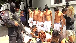 Gang violence in El Salvador surges as gangs battle authorities.