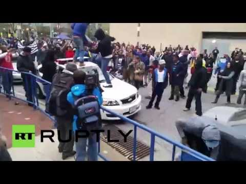 Baltimore: Protesters smash cars clash with police