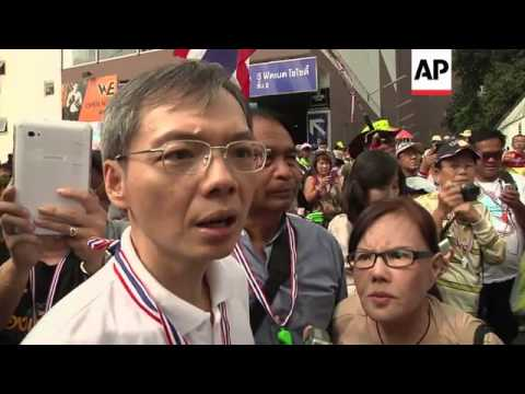 Anti-government protest, leader collects donations, scene of small explosion