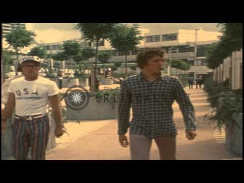 Athletes walk about in the Olympic village during the 1972 Summer Olympics held iHD Stock Footage