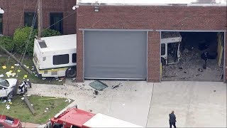 City bus crashes into warehouse in Detroit