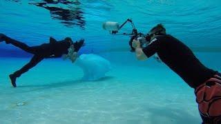 Adventurous Bride and Groom Pose For Underwater Wedding Photos