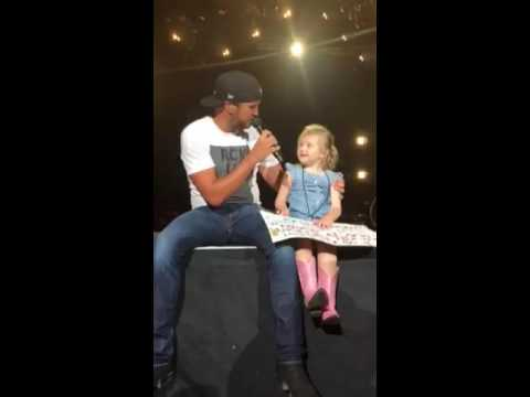 Luke Bryan brings 5 year old Bella on stage and she steals the show.