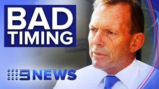 Tony Abbott runs into climate change rally | Nine News Australia