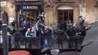 Clashes: Football fans battle before Champions League game in Manchester