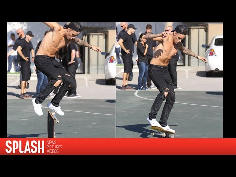 Justin Bieber Skateboards Around New York Shirtless