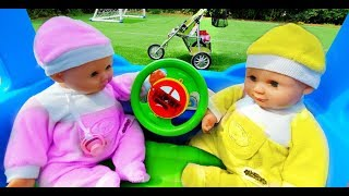 Funny Baby Dolls Playing with Colored Balls on the Little Bus and Ride on Pushchair