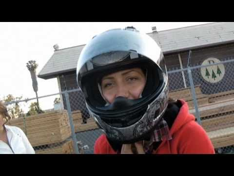 Hot girl does motorcycle stunt Video