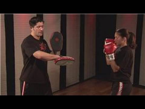 Kickboxing : Holding Pads for Elbow Strikes Image 1