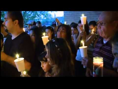 Candlelight vigil for victim of strip club shooting
