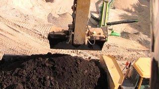 Cat 325D Excavator Loading Volvo A25E Dumper: Boom Cylinder View