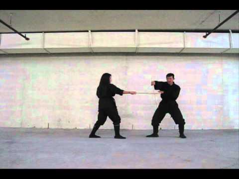 Stick fighting with Kim Kunoichi (#5 basic block)