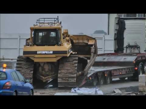 Bulldozer slips off truck