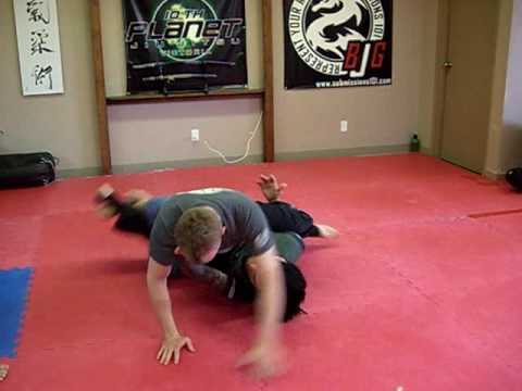 Handcuffing: Half Guard Sweep Image 1