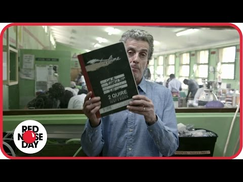 Peter Capaldi examines the 'death book' in a children's ward in Malawi