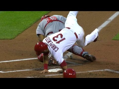 CIN@STL: Carpenter leaps over catcher to score