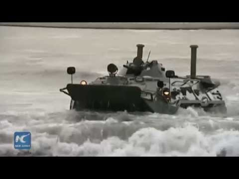 RAW: BTR-80s crash through waters for Russia's Centre-2015 mass military drills