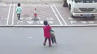 Seven-year-old boy rescues kid hit by tricycle in south China