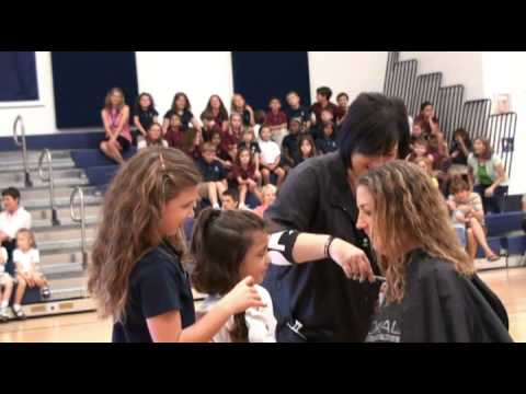 Academy at the Lakes faculty and teachers donate to Locks of Love 8 26 09