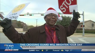 This crossing guard in Round Rock will brighten your day