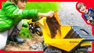 Dump Trucks Haul Mole Dirt