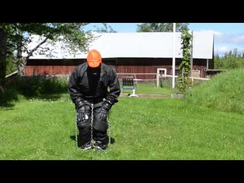 Full covered in PVC Rainwear, gasmask and chains