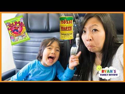 Super Sour Candy Challenge Kid on the Airplane with Rock Scissors paper