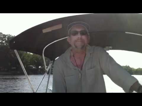 Attorney Tom Olsen boating on the St. John's River near Astor Florida