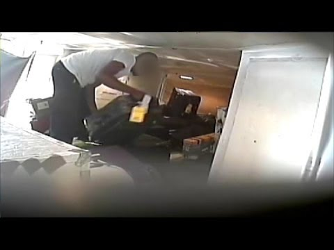 Holiday Travel Alert: Baggage Handlers Caught on Tape Stealing