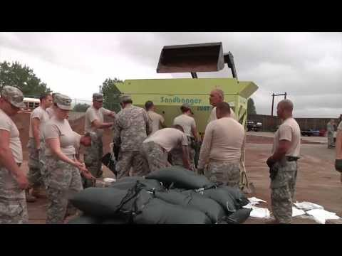 Flooding in Colorado!  National Guard Soldiers and Airmen fill and distribute sandbags!