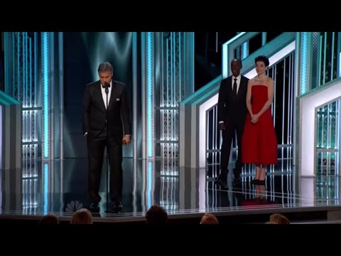 Julianna Margulies presents the DeMille Award to George Clooney