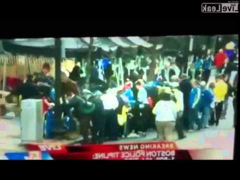 Post Boston Marathon bombing looters stealing marathon jackets,while others are just feet away criti