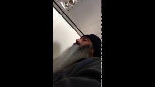 Idiot films selfie next to Sikh on airplane, asks