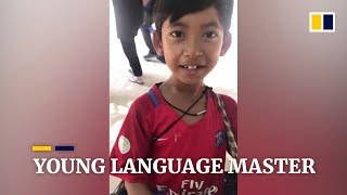 Cambodian boy masters 12 languages selling souvenirs to tourists