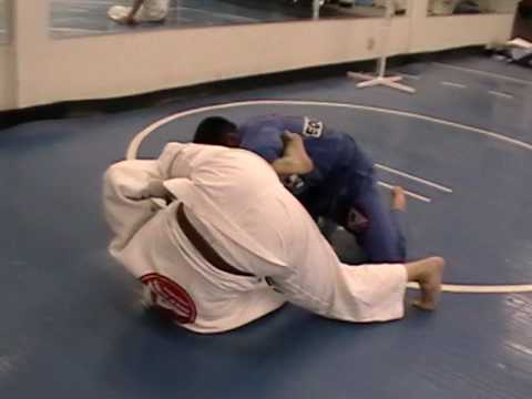 BJJ Techniques: Spider Guard to Roll-Under Omoplata Image 1