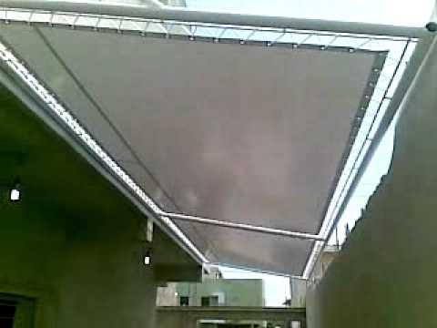 Toldo de lona youtube for Rieles para toldos de techo