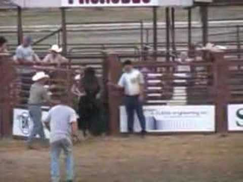 Kids Riding a bull in a rodeo in Emery County.