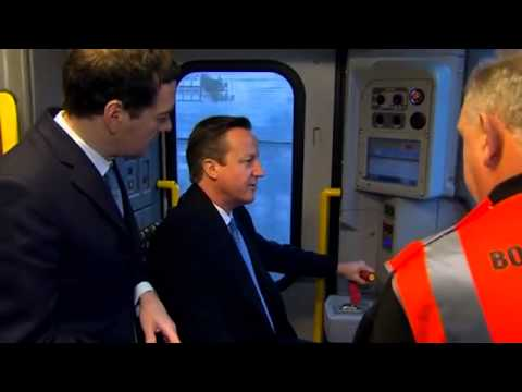 General election 2015: David Cameron drives train to show country 'on track'