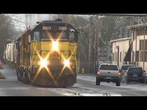 (HD) P&W Freight Train running down the Street