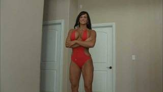 Tall big fitness lady posing and flexing
