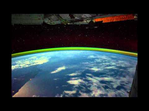 View of Earth from Space Station at night (Aurora, storms, cities and stars)