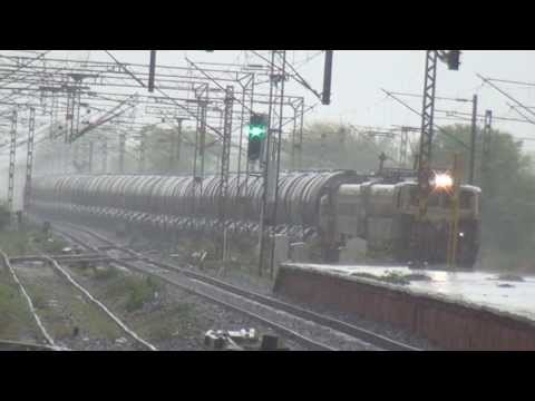 2 TRAINS CROSSING EACH OTHER IN HEAVY RAINS - INDIAN RAILWAYS !!!!!