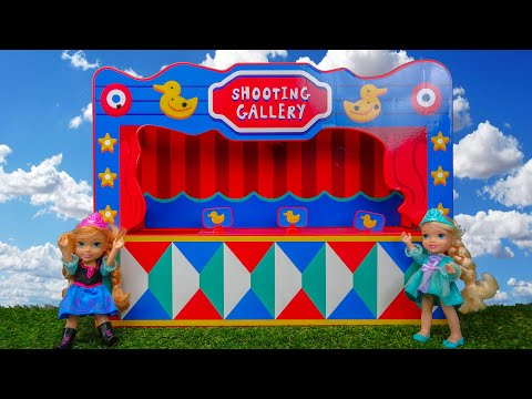 Elsa and Anna toddlers games at the funfair